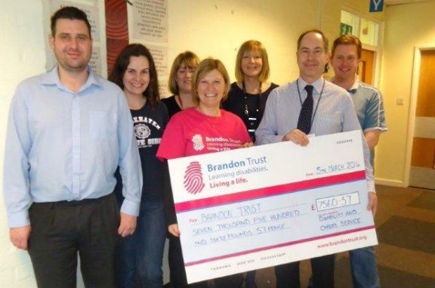 DWP team handing a cheque over to The Brandon Trust