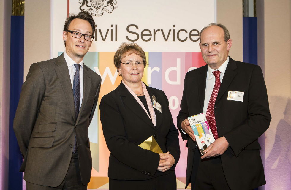 Richard (far right) receiving his award from MoJ Perm Sec Ursula Brennan