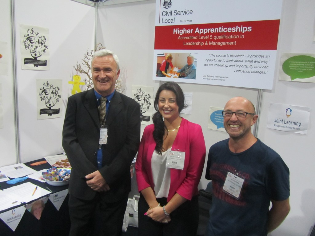 Smiling volunteers at apprenticeship stall