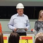 Man in a builder's safety helmet