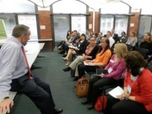 John Manzoni listening to delegates of the 2015 academy