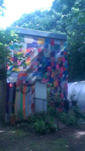 Citizens covered the day centre's shed in knitted squares