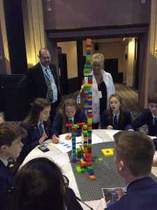 Children building a tower made of building blocks