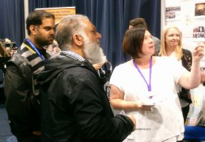 Interested attendees at a stand at CS Live