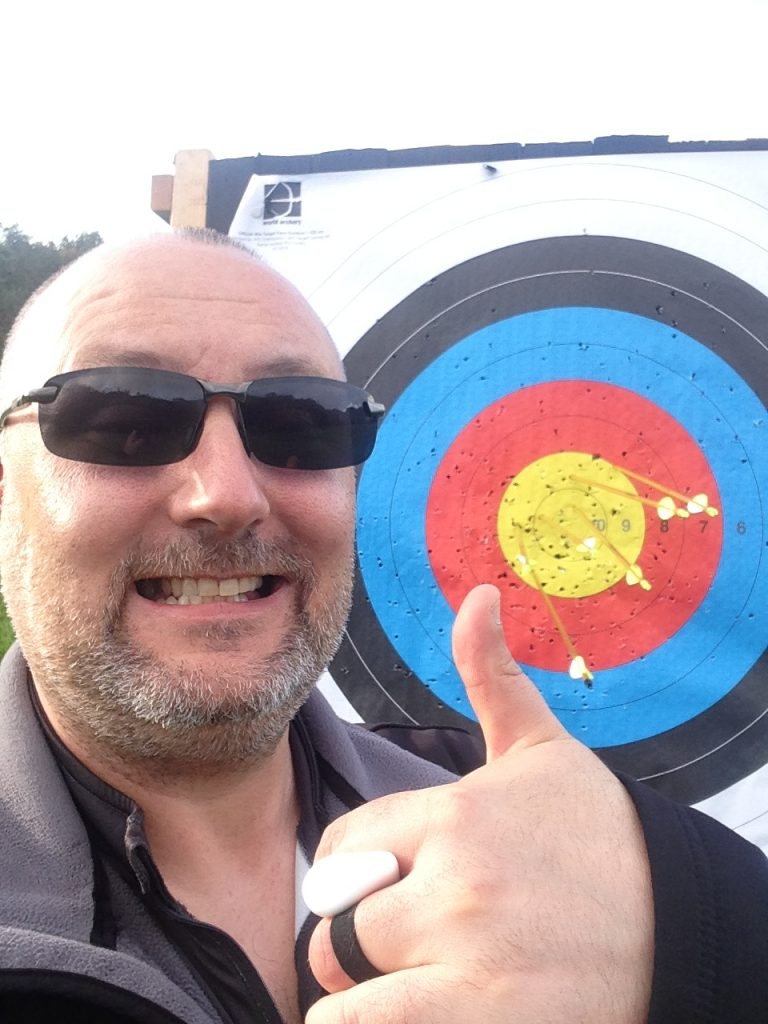 Paul gives a thumbs-up by an archery target