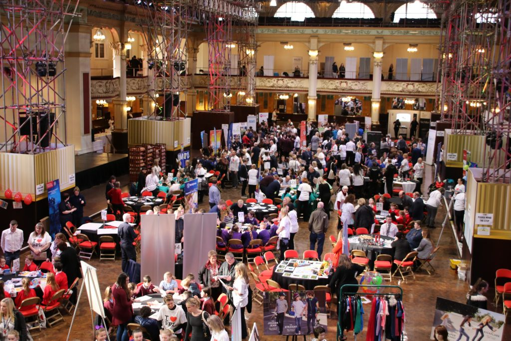 Busy display stands and activity tables in the main hall
