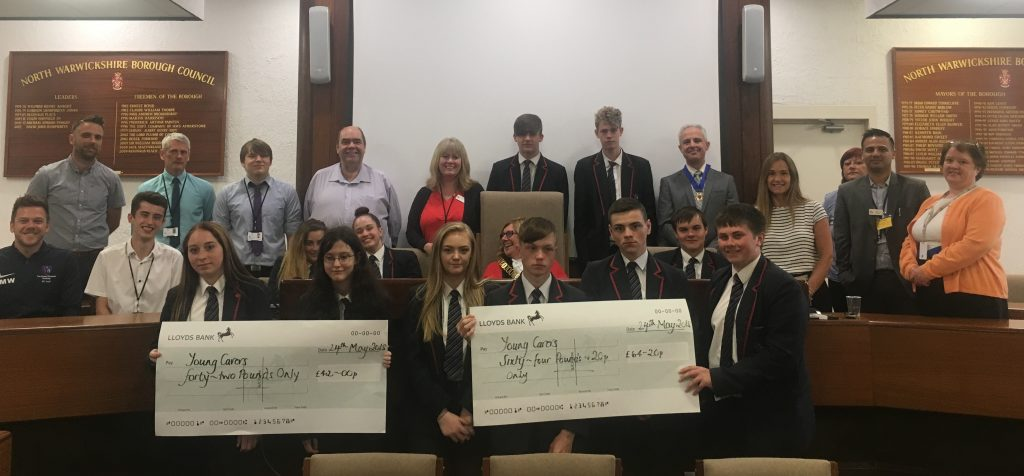 The Young Carers with their Civil Service Mentors at Atherstone Town Hall receiving their certificates from the Mayor. They are holding two huge cheques, being the amount they raised in the course of their project with North Warwickshire Aspire.