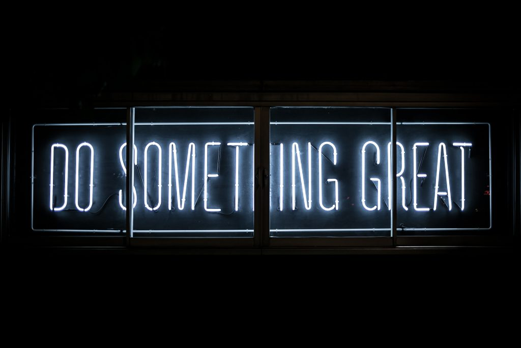 "A neon sign saying ""Do Something Great"""