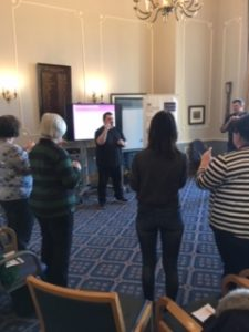 People stood in room using sign language
