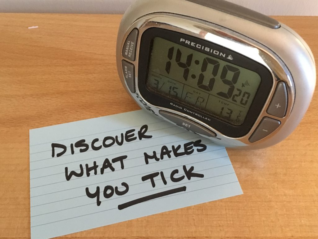 Digital clock beside the words Discover What Makes You Tick