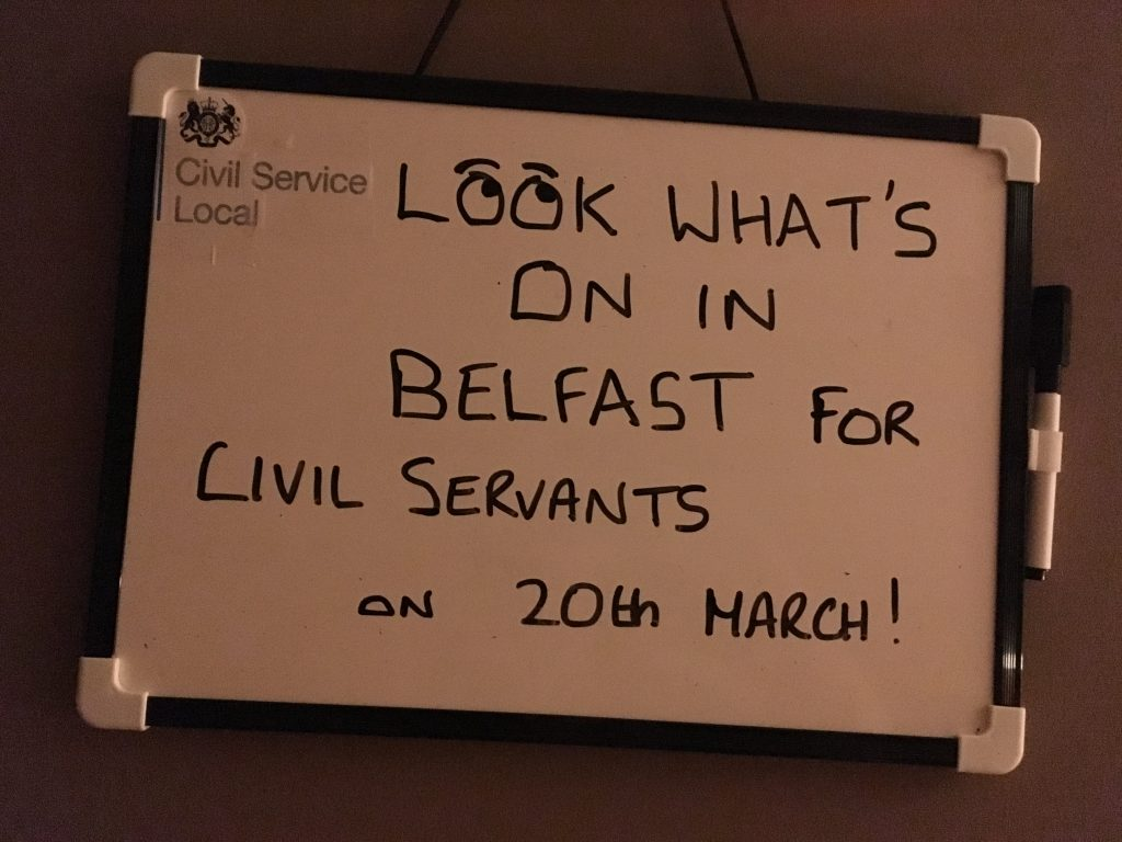 Whiteboard with writing - look what's on in Belfast for civil servants on 20th March