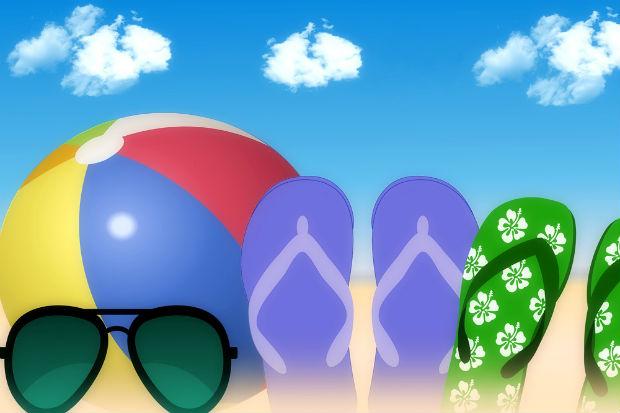 beach ball, sunglasses, flipflops blueskies portraying summer holidays