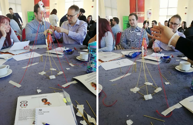 2 difference pictures next to each other, both showing people making a model from straws and stationery at a table from a previous event