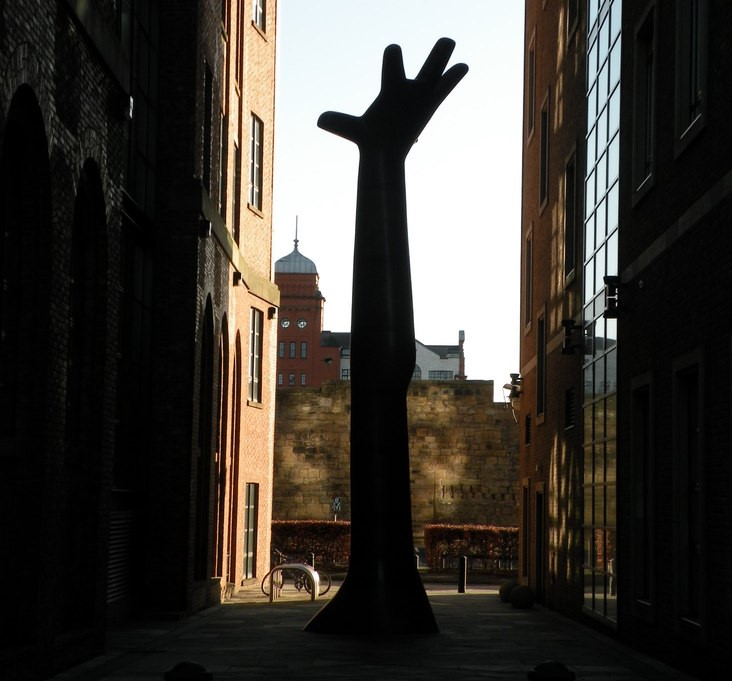 Statue of a hand reaching up