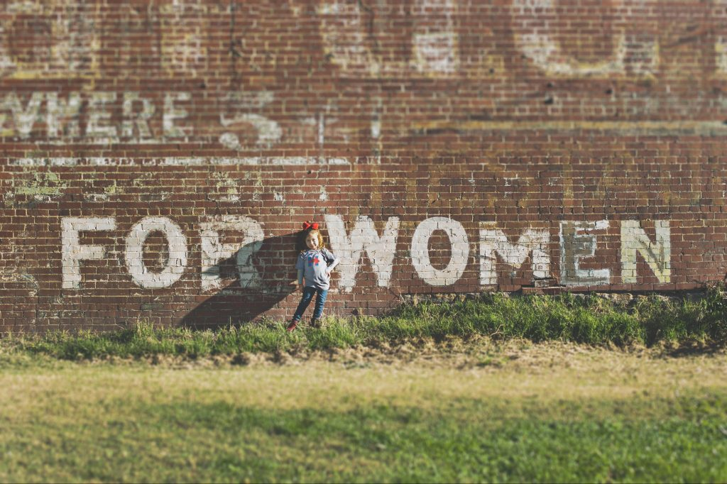 brick wall with the words 'for women'