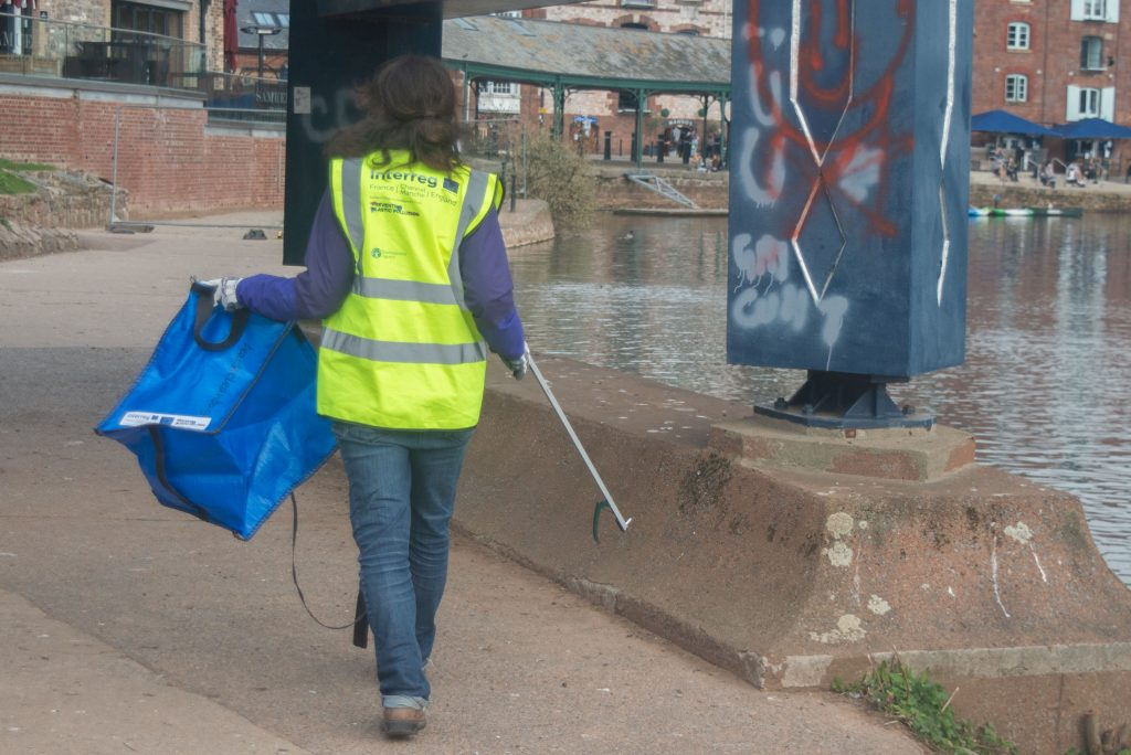 person picking up litter