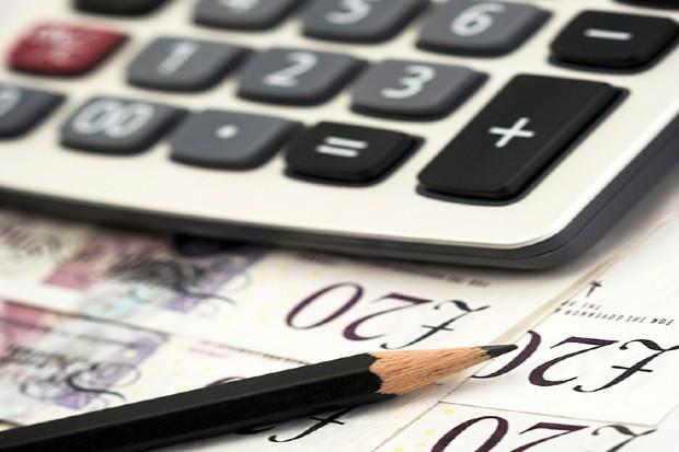 bills,pen and calculator close up